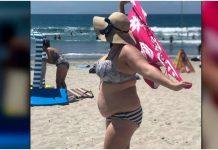 Grupa muškaraca se rugala ženi u bikiniju