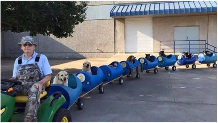 Umirovljenik pretvorio traktor i bačve u vlak kojim prijevozi pse lutalice