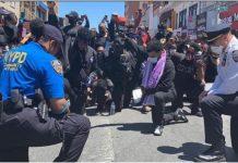 Policajci mole i kleče pored prosvjednika u američkim gradovima